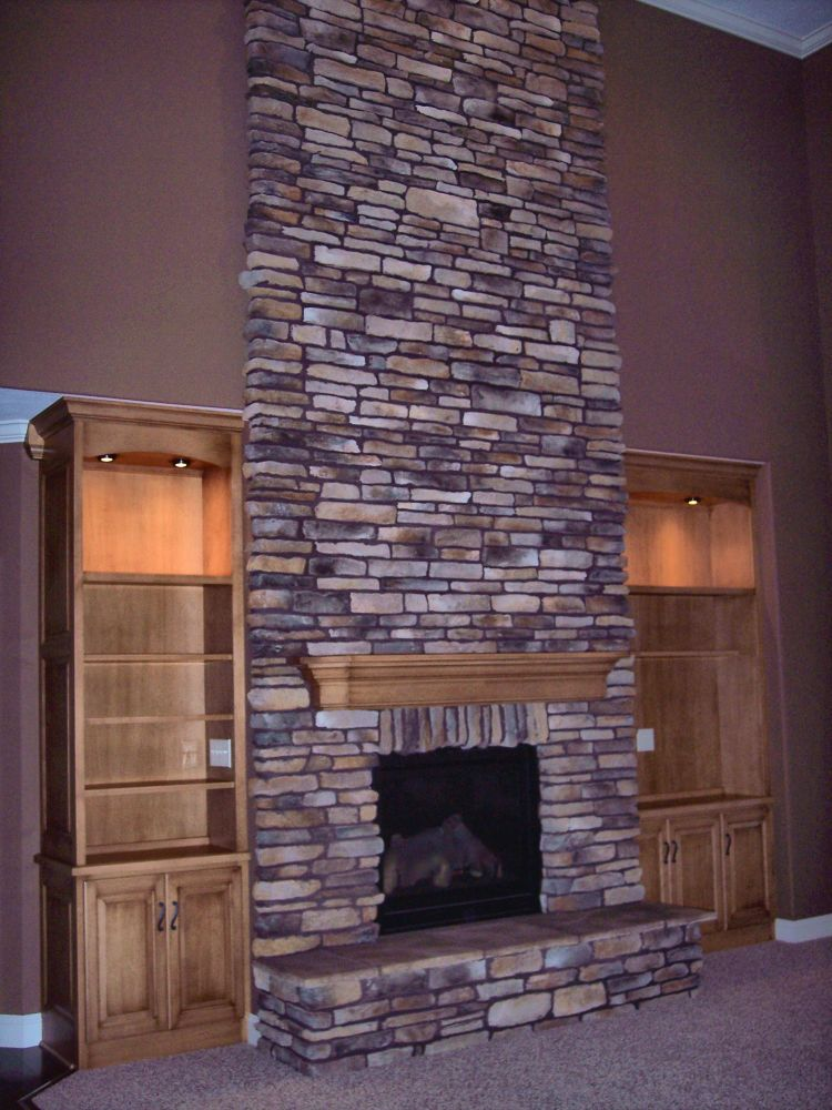 Stone for fireplace engineered stone surround this tv for Engineered fireplace